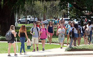 Crowd of Students Walking Across Campus